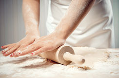 Woman kneading dough Stock Image