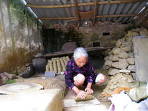 Woman kneading soil before clay ceramic Stock Photo
