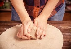 Woman kneads the clay Stock Photography
