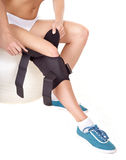 Woman with knee brace. Royalty Free Stock Photo