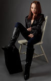 Woman in Knee High Black Boots Stock Image