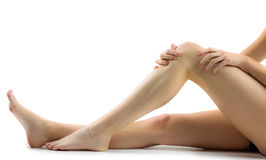Woman with knee injury Stock Images