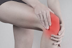 Woman with knee pain close up. Pain relief concept Stock Photography