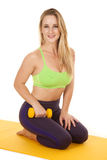 Woman kneel green sports bra hold weight Stock Photography