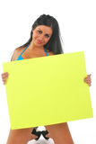 Woman kneeling holding sign Royalty Free Stock Photography