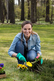 Woman kneeling during working in garden Royalty Free Stock Photography