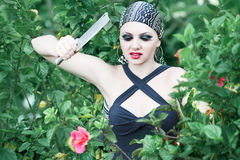 Woman with a knife Royalty Free Stock Photography