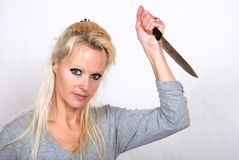 Woman with knife Stock Image