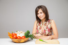 Woman with knife is going to cook Royalty Free Stock Images