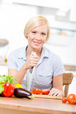 Woman with knife is going to prepare breakfast Stock Photo