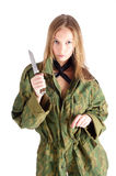 Woman with knife on white. Beautiful sexy blond woman holding hunter knife Royalty Free Stock Photos