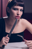 Woman with a knife Stock Images