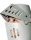 Woman with knight's helmet on the head Stock Images