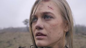 The dying Jeanne D`ark cries. A woman knight in wounds and soot looks into the distance and cries stock footage