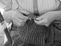 Woman knit with knitting needles Stock Images
