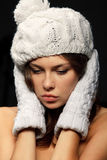 Woman in knit white mittens and cap Royalty Free Stock Photo