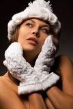 Woman in knit white mittens and cap Stock Image