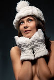 Woman in knit white mittens and cap Royalty Free Stock Photos