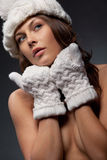 Woman in knit white mittens and cap Stock Photos