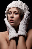 Woman in knit white mittens and cap Stock Photography