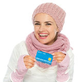 Woman in knit winter clothing holding cred card Royalty Free Stock Photography
