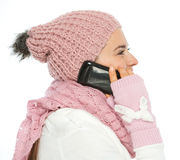 Woman in knit winter clothing speaking mobile Stock Photography