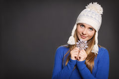 Woman in knit wool hat with snowflake Royalty Free Stock Images
