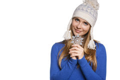 Woman in knit wool hat with snowflake Royalty Free Stock Photo