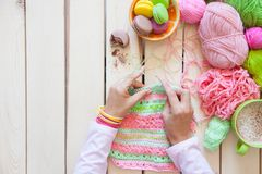 A woman knits a bright colored canvas with spokes. Hands close-u Royalty Free Stock Photos