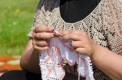 Woman knits knitting needles rare knitted fabrics Stock Images