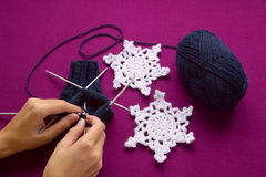Woman knits mittens on the needles Royalty Free Stock Photo