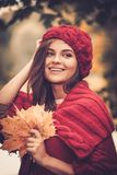 Woman in knitted coat in autumn park Royalty Free Stock Photo