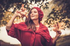 Woman in knitted coat in autumn park Royalty Free Stock Images