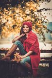 Woman in knitted coat in autumn park Royalty Free Stock Image