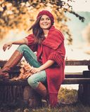 Woman in knitted coat in autumn park Royalty Free Stock Photos