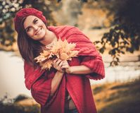 Woman in knitted coat in autumn park Stock Images