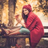 Woman in knitted coat in autumn park Stock Photos