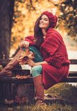 Woman in knitted coat in autumn park Stock Photo