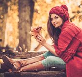 Woman in knitted coat in autumn park Royalty Free Stock Photography
