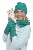 Woman with knitted hat and a cat Royalty Free Stock Photography