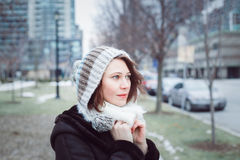 Woman in knitted hat outside on cold winter day Royalty Free Stock Image