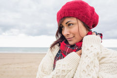 Woman in knitted hat and pullover on the beach Stock Photography