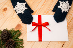 Woman in knitted mittens keeps a Christmas letter Stock Photography