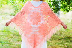 Woman in  knitted poncho in nature Royalty Free Stock Photo