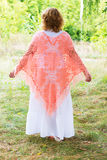 Woman in  knitted poncho in nature Royalty Free Stock Image