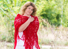 Woman in  knitted shawl in nature Stock Image