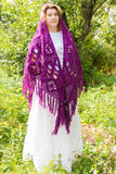Woman in  knitted shawl in nature Stock Photos