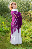 Woman in knitted shawl in nature royalty free stock photography