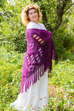 Woman in  knitted shawl in nature Stock Images
