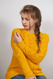Woman in a knitted sweater Stock Images